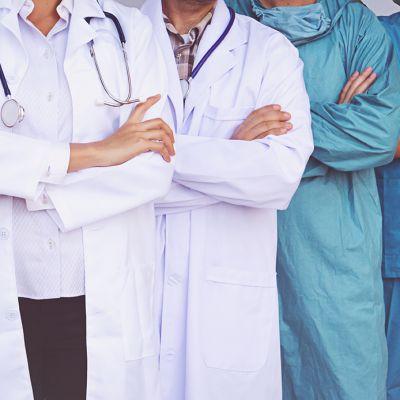 Doctors and Nurses coordinate hands. Concept Teamwork