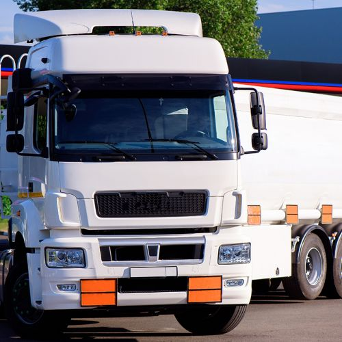 Fuel tanker track driving. Oil and gas transportation by truck.