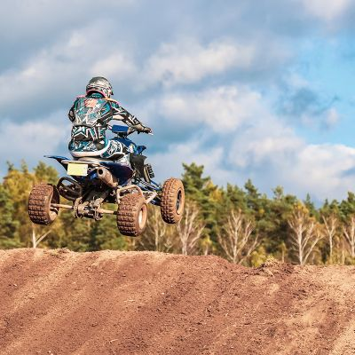 Motocross competition, the man jumps on quad bike, extremal kind of sports